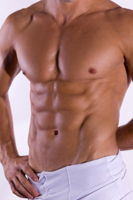 women are drawn to defined male abs